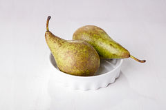 Two pears in porcelain dish Stock Images