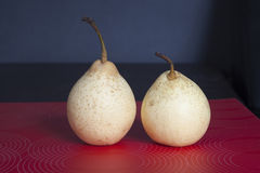 Two pears on a red striped napkin Royalty Free Stock Images