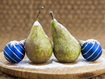 Two pears and two Christmas balls Stock Photos