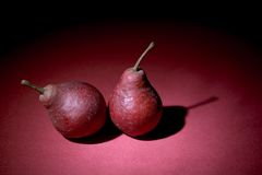 Two pears on violet. Background Stock Photography