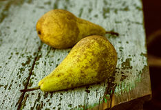 Two pears on wooden background Royalty Free Stock Images