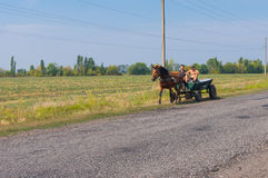Two peasant using horse and cart as ecological transportation Stock Photography