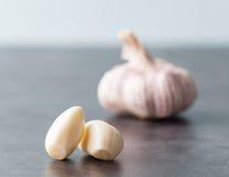 Two peeled garlic cloves. Royalty Free Stock Image