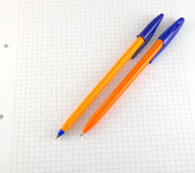 Two pen on the checked paper Royalty Free Stock Images