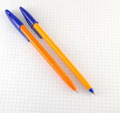 Two pen on the checked paper Royalty Free Stock Photos
