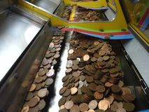 A penny falls game in an amusement arcade stock footage