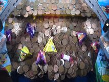 A penny falls game in an amusement arcarde stock footage