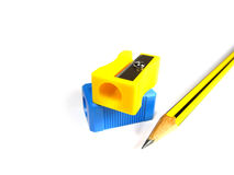 Two pencil sharpeners. On the white background Royalty Free Stock Photo
