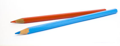 Two pencils, red and blue Royalty Free Stock Image