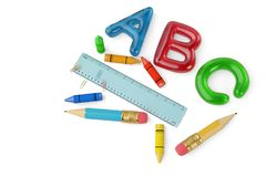 Two pencils and crayons and ruler and color ABC letters on white. Background 3d illustration vector illustration