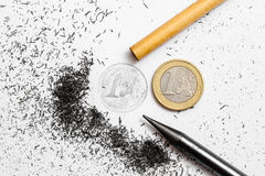 Two pencils and one euro coin. One Euro coin drawing and pencil on white background Stock Photo