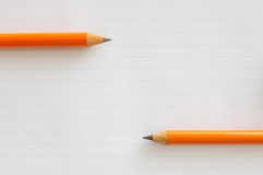 Two pencils on paper Stock Photography