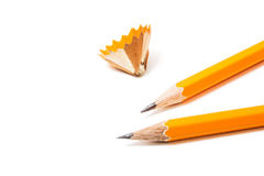 Two Pencils with sharpening shavings on white background. stationery. Isolated Office tool. Two yellow pencils isolated on white Stock Image