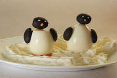Two Penguins. On the ice. A food for children Stock Photo
