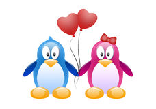 Two Penguins with Red Balloons Royalty Free Stock Photo