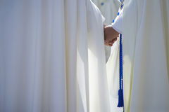 Two penitents hand in hand in a Holy week procession Royalty Free Stock Photo