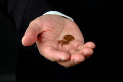 Two Pennies Worth. Hand of Businessman Offering Two Pennies stock photo