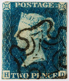 Two Penny Blue with black postmark. 1840 Two Penny Blue with a black Maltese Cross postmark stock images