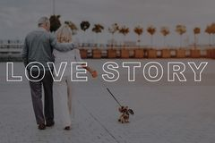 Two Pensioners Go Hugging. Couple Love Story. stock photos
