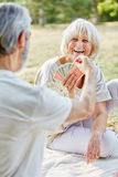 Two pensioners playing cards Stock Photos