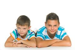 Two pensive brothers on the floor Royalty Free Stock Images