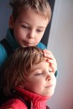 Two pensive children. Portrait of Two pensive children Stock Image