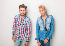 Two pensive young casual men looking at the camera Royalty Free Stock Images