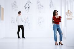 Two people in art museum. Two people in an art museum looking at the exhibition Stock Images