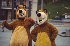 Two people in that bear costume. Two men in a bear costume in the city, in day of protection of animals, festive entertainment Stock Photo