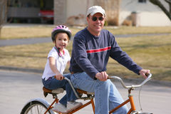 Two people on a bicycle stock images