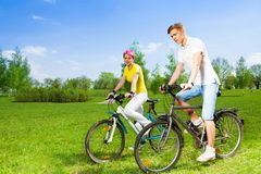 Two people on bikes Stock Photo