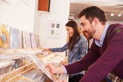 Two people browsing through records at a record shop stock image