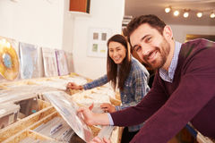 Two people browsing records at a record shop, portrait Royalty Free Stock Photography