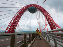 Two people on cable stayed bridge Royalty Free Stock Image