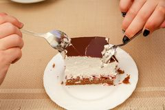 Two people in cafe are eating delicious cake_ stock photo