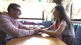 Two people in cafe enjoying the time spending with each other. Two people in a cafe enjoying the time spending with each other stock footage