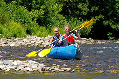 Two people in canoe stock images