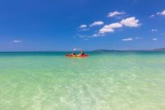 Two people canoeing in the andaman sea ,Krabi, Thailand. Two people canoeing in the andaman sea Thailand Royalty Free Stock Photography