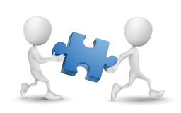 Two people carried a puzzle. Over white background Royalty Free Stock Photo