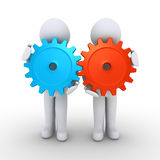 Two people with cogs as teamwork concept. Two 3d people are holding connected cogwheels Stock Photo