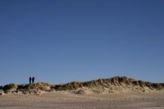 Two people on Danish dunes royalty free stock photo