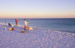 Two people deep sea fishing Royalty Free Stock Image
