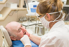 Two people dentist and patient Stock Photography