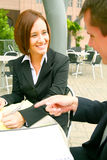 Two People Discussing. Two business people discussing. focusing on the woman. outdoor in modern cafe setting Royalty Free Stock Photography