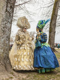 Two People Disguised Discussing. Annecy,France-March 15,2014:Two people disguised discuss in a forest during the Annecy Venetian Carnival. Yearly in Annecy Royalty Free Stock Photo