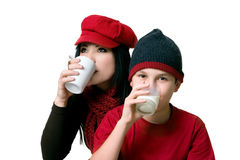 Two people drinking beverages Royalty Free Stock Photo