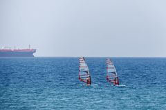 Two people are engaged in Windsurf-Kitesurf. In the Mediterranean Sea Royalty Free Stock Image