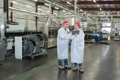 Two people in factory. People stock image