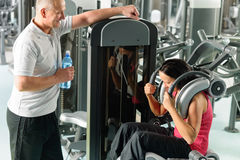 Two people at fitness center exercise abdominal Royalty Free Stock Images
