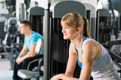 Two people at fitness center exercise machine Stock Photography
